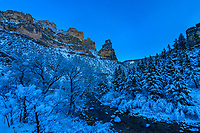 Fresh snow at Tongue River Canyon reflects the deep blue twilight sky as day turns to night.