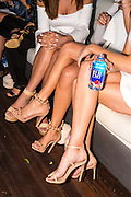 Kookai Cruise Event and Fashion Show 2016 with Fiji water being sampled by guests, Sydney Harbour.