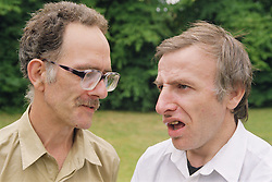 Two men with learning disabilities talking in garden,