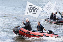 © Licensed to London News Pictures. 15/06/2016. London, UK. Brendan Cox (foreground, right), husband of Labour MP Jo Cox, drives an 'IN' campaign protest boat as Nigel Farage leads a flotilla of pro-Brexit fishing boats down the River Thames. Jo Cox MP died on Thursday 16 June 2016 after being shot and stabbed in Birstall, Leeds. Her husband has urged people to 'fight against the hatred' that killed his wife. Photo credit: Rob Pinney/LNP