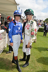 Left to right, PHILIPPA HOLLAND and EDIE CAMPBELL at the 2014 Glorious Goodwood Racing Festival at Goodwood racecourse, West Sussex on 31st July 2014.