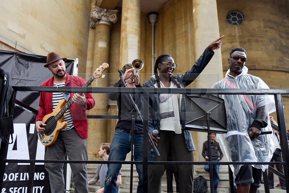 """© Licensed to London News Pictures. 02/06/2017. London, UK. The band Captain Ska plays their song Liar Liar live as demonstrators gather outside the BBC headquarters in protest against the Corporation for not playing the song """"Liar Liar"""" by Captain Ska on BBC Radio 1.  Organised by The People's Alliance, people carried signs bearing an image of Prime Minister Theresa May with the words """"Liar Liar"""" and """"You Can't Trust Her"""" on each side.   Photo credit : Stephen Chung/LNP"""