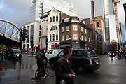 Street scene of old and new on a wet day at Borough / London Bridge on 27th November 2019 in London, England, United Kingdom. This area got its name from when it was the only borough outside the City of London. Borough High Street is the areas main street, and it is famous for Borough Market, Guys Hospital and London Bridge station.