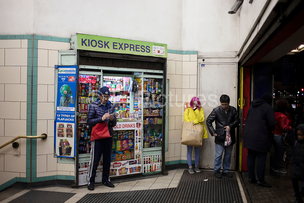 People waiting outside a kiosk at the entrance to Mile End underground station in East London, United Kingdom. (photo by Mike Kemp/In PIctures via Getty Images)