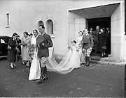 18/11/1952<br /> 11/18/1952<br /> 18 November 1952<br /> Wedding of Lieutenant Seamus Lillis, (son of Colonel James Lillis, Army Chief of Staff) Collins Barracks, Cork and Miss Aureed Mundy, Donegal at Ross Nuala and Bundoran, Co. Donegal. The wedding party outside the church at Ross Nuala. The couple leaving the church after the ceremony.