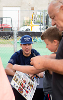 KELOWNA, CANADA - JUNE 28: NHL Vancouver Canucks player Luke Schenn sits at an autograph table during the opening charity game of the Home Base Slo-Pitch Tournament fundraiser for the Kelowna General Hospital Foundation JoeAnna's House on June 28, 2019 at Elk's Stadium in Kelowna, British Columbia, Canada.  (Photo by Marissa Baecker/Shoot the Breeze)