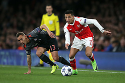 Arsenal's Alexis Sanchez and Bayern Munich's Marcio Rafinha (left) during the UEFA Champions League Round of 16, Second Leg match at the Emirates Stadium, London.