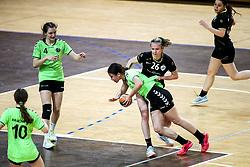 Neja Polak of RK Krim Mercator and Tanaja Cesnik of RK Olimpija during handball match between RK Olimpija and RK Krim Mercator in Round #13 of National Youth League in Season 2020-21, on May 23, 2021 in Hala Tivoli, Ljubljana, Slovenia. Photo by Matic Klansek Velej / Sportida
