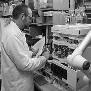Ben in the lab testing and calibrating a liquid chromatograph used to analyze organic molecules in seawater