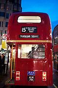Red Routemaster bus number 15 towards Trafalgar Square.