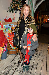 Charlotte Tilbury's mother PATSY DODD and FLYNN FORBES at a promotional party for the A Girl For All Time doll held at HoneyJam, 2 Blenheim Crescent, London on 5th December 2015.