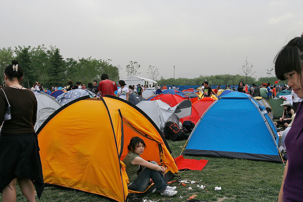 A tent village is set up at Midi Festival in Beijing China 2007. No overnight camping is allowed at Haidain Park where the festival is held. Midi is an  rock music festival held in northern Beijing catering to a small group of music listeners in China.  The festival lasts 4 days and gives performances from Chinese and international bands.