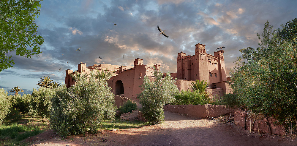 Towering Delusions - Adobe buildings of the Berber Ksar or fortified village of Ait Benhaddou with storks circling and nesting at sunset, Sous-Massa-Dra Morocco. By photographer Paul E Williams .<br /> <br /> Visit our LANDSCAPE PHOTO ART PRINT COLLECTIONS for more wall art photos to browse https://funkystock.photoshelter.com/gallery-collection/Places-Landscape-Photo-art-Prints-by-Photographer-Paul-Williams/C00001WetsxVxNTo