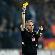 Referee's Mustafa Kamil Abitoglu show the yellow card to during their Turkish superleague soccer match Kardemir Karabukspor between Galatasaray Dr. Necmettin Seyhoglu stadium in Karabuk Turkey on Saturday 13 April 2013. Photo by Aykut AKICI/TURKPIX