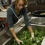 """Volunteer washing collard greens three times in kitchen sink, food for Thanksgiving being prepared a week in advance in Sister Jean's Kitchen. A former casino chef, Webster, 74, found her calling when she saw a man rummaging through a garbage can in search of food. Now she runs a soup kitchen that feeds up to 400 homeless people a day, five days a week in the dinning room of the First Presbyterian Church of Atlantic City. No one is turned away. Jean has been called """"Sister Jean"""" or """"Saint Jean"""" or """"the Mother Teresa of Jersey."""""""