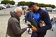 Jake Jervis (10) of AFC Wimbledon signing his autograph for a fan on arrival at Home Park stadium before the EFL Sky Bet League 1 match between Plymouth Argyle and AFC Wimbledon at Home Park, Plymouth, England on 6 October 2018.
