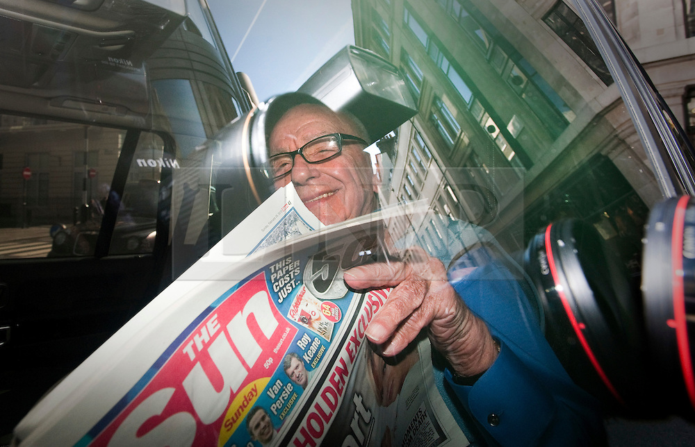 © Licensed to London News Pictures. 26/02/2012. London, UK. RUPERT MURDOCH, Chairman and CEO of News Corporation reading a copy of The Sun on Sunday as he leaves his home in central London on February 26th, 2012. The Sunday edition of The Sun was launched today (26th/02/2012) after News International closed its Sunday paper, the News of the World, last year amid the scandal over phone hacking. Photo credit : Ben Cawthra/LNP
