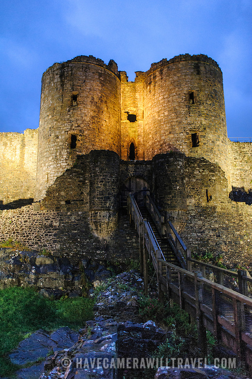 A walking bridge leads to the gatehouse at Harlech Castle in Harlech, Gwynedd, on the northwest coast of Wales next to the Irish Sea. The castle was built by Edward I in the closing decades of the 13th century as one of several castles designed to consolidate his conquest of Wales.