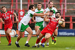 11th November 2018 , Racecourse Ground,  Wrexham, Wales ;  Rugby League World Cup Qualifier,Wales v Ireland ; Rhys Williams of Wales is tackled by Declan O'Donnell of Ireland <br /> <br /> <br /> Credit:   Craig Thomas/Replay Images