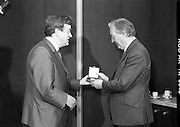 First Millennium 50p Coin.   (R80)..1988..31.06.1988..06.31.1988..31st June 1988..The Governor of the Central Bank of Ireland, Mr Maurice F Doyle, presented the first of a limited issue of proof 50p coins commemorating the Dublin Millennium to An Taoiseach, Charles Haughey TD, this morning. Only 50,000 of these frosted proof coins will be issued for worldwide distribution...Image shows An Taoiseach, Charles Haughey TD, being presented with the first of the new 50p coins by Mr Maurice Doyle, Governor, Central bank of Ireland.