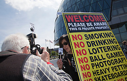 © under license to London News Pictures. 03/05/2011. On World Press Freedom Day around 50 photographers gathered in a Flashmob outside City Hall, London, to protest against the behaviour of private security guards towards photographers. Organised by PhotographerNotATerrorist.org, a letter was delivered to London Mayor Boris Johnson to bring it to the public's attention. In this photo: David Hoffman and Leah from the organisers. Photo credit should read BETTINA STRENSKE/LNP