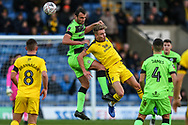 Forest Green Rovers Farrend Rawson(6) and Oxford United's Sam Smith(9) challenge for the ball during the The FA Cup 1st round match between Oxford United and Forest Green Rovers at the Kassam Stadium, Oxford, England on 10 November 2018.