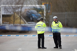 © Licensed to London News Pictures . 14/03/2013 . Rochdale , UK . The area is sealed off to traffic and pedestrians . Specialist investigators from Greater Manchester Fire and Rescue examine a suspicious device found at The Point Retail Park in Rochdale  using a device used to measure radiation levels . The retail park was evacuated this afternoon (14th March) following the discovery . Police say the discovery is a radioactive canister stolen from a van in Bacup last month . Photo credit : Joel Goodman/LNP