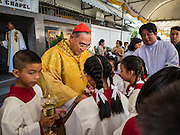 18 SEPTEMBER 2016 - BANGKOK, THAILAND: FRANCIS XAVIER KRIENGSAK, the Archbishop of Bangkok, greets alter servers at Santa Cruz Church before leading the church's 100th anniversary mass. Santa Cruz Church was establised in 1769 to serve Portuguese soldiers in the employ of King Taksin, who reestablished the Siamese (Thai) empire after the Burmese sacked the ancient Siamese capital of Ayutthaya. The church was one of the first Catholic churches in Bangkok and is one of the most historic Catholic churches in Thailand. The first sanctuary was a simple wood and thatch structure and burned down in the 1800s. The church is in its third sanctuary and was designed in a Renaissance / Neo-Classical style. It was consecrated in September, 1916. The church, located on the Chao Phraya River, serves as a landmark for central Bangkok.       PHOTO BY JACK KURTZ