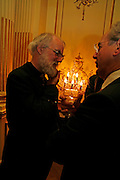 The Archbishop of Canterbury, Rowan Will, Seamus Heaney reading and party. Irish Embassy. Grosvenor Place. 21 April 2006. ONE TIME USE ONLY - DO NOT ARCHIVE  © Copyright Photograph by Dafydd Jones 66 Stockwell Park Rd. London SW9 0DA Tel 020 7733 0108 www.dafjones.com
