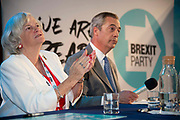 Brexit Party MEP Ann Widdecombe listens as Brexit Party leader Nigel Farage answers media questions at an event to introduce prospective parliamentary candidates in central London, United Kingdom on 27th August, 2019.