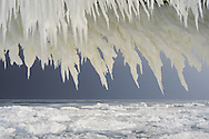 A look through some jagged ice formations to the pancake ice on Lake Michigan.<br /> St. Joseph, Michigan