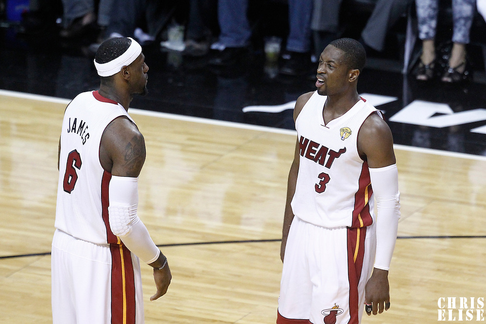 21 June 2012: Miami Heat shooting guard Dwyane Wade (3) talks to Miami Heat small forward LeBron James (6) during the Miami Heat 121-106 victory over the Oklahoma City Thunder, in Game 5 of the 2012 NBA Finals, at the AmericanAirlinesArena, Miami, Florida, USA. The Miami Heat wins the series 4-1.