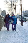Homeless men age 50 walking in the dead of winter.  St Paul Minnesota USA