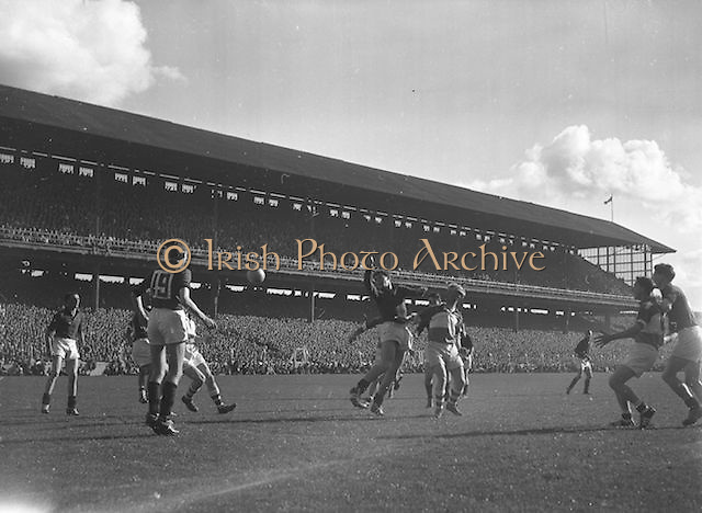 Ball flies between players during the All Ireland Senior Gaelic Football Final Down v. Offaly in Croke Park on the 24th September 1961. Down 3-6 Offaly 2-8.
