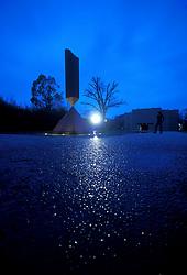 Stock photo of Barnett Newman's sculpture, Broken Obelisk at night at the Rothko Chapel in Houston Texas