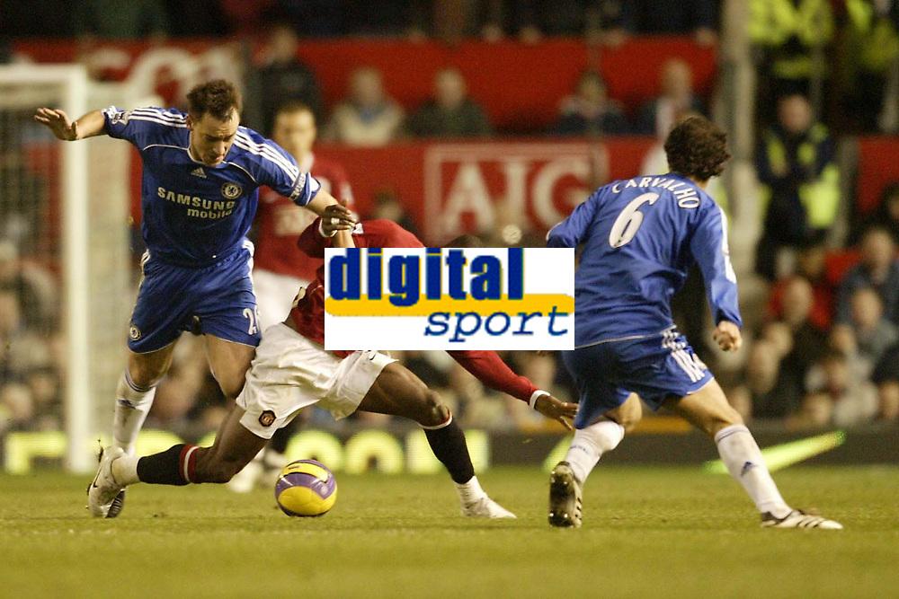 Photo: Aidan Ellis.<br /> Manchester United v Chelsea. The Barclays Premiership. 26/11/2006.<br /> United's Louis Saha is caught by Chelsea's John Terry as Ricardo Carvallho looks on