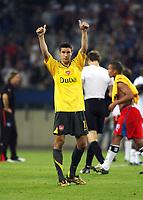 Photo: Chris Ratcliffe.<br /> Hamburg v Arsenal. UEFA Champions League, Group G. 13/09/2006.<br /> Robin Van Persie of Arsenal celebrates victory at the end.