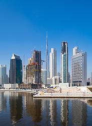 Daytime view of modern skyline of Business Bay and The Creek waterway  in Dubai, United Arab Emirates