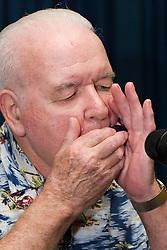 Man playing mouth organ,