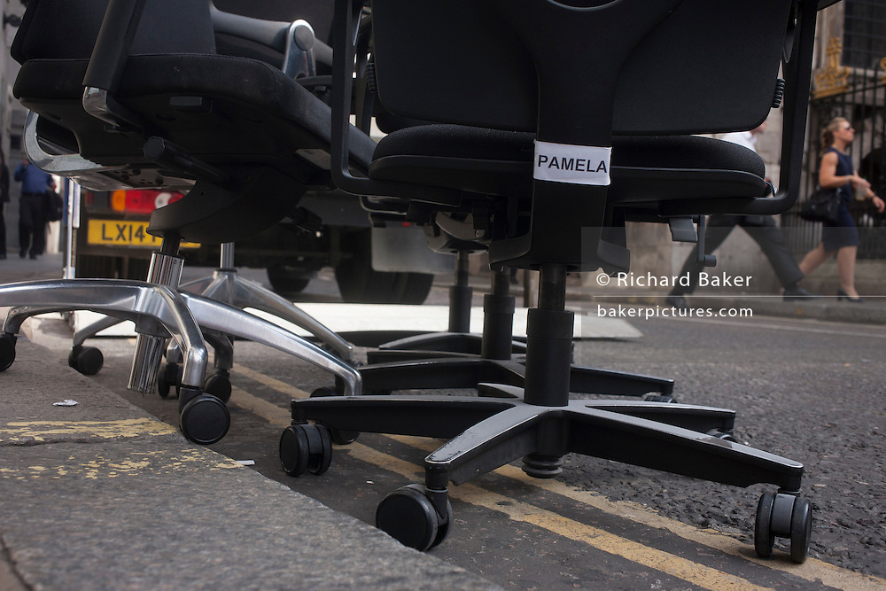 Office chair furniture left in a street on 13th September 2016, in the City of London, England.