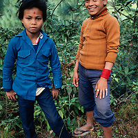 Nepal youngsters stand by a trail in the Kathmandu Valley, Nepal.