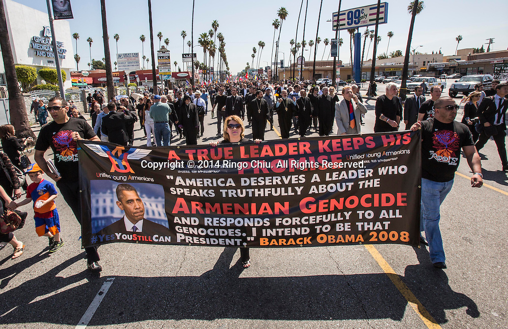 Thousands of Armenians march along Hollywood Boulevard to mark the 99th anniversary of the beginning of the Armenian genocide and to call on the Turkish government to recognize the deaths of about 1.5 million people, in Los Angeles on Thursday, April 24, 2014. (Photo by Ringo Chiu/PHOTOFORMULA.com)