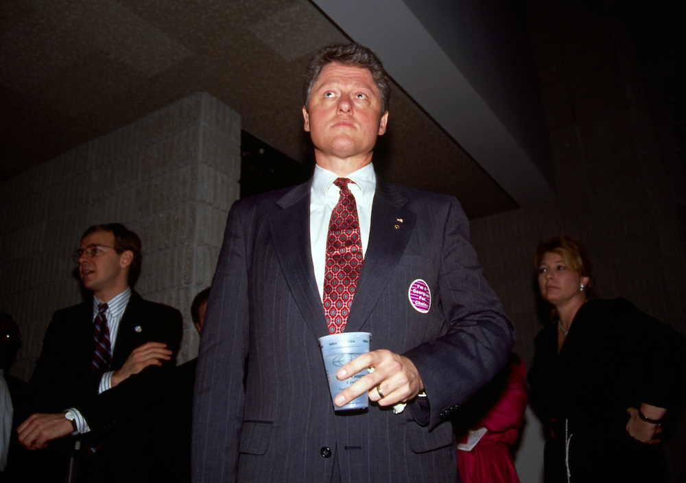 A youthful looking Arkansas Governor Bill Clinton waits his turn backstage before a speech to Georgia Democrats in 1992.