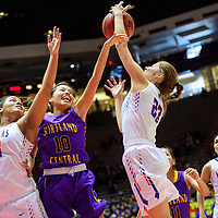 Kirtland Central Bronco Haile Gleason (10), center, reaches for a rebound between Los Lunas Tigers Maya Trujillo (55), left, Ashley Blackwell (23) in a District 5A semifinal at The Pit in Albuquerque Thursday.