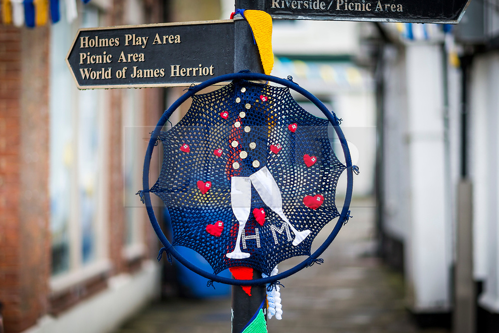 © Licensed to London News Pictures. 13/05/2018. Thirsk UK. The Thirsk Yarn bombers have decorated the town centre of Thirsk in North Yorkshire this morning with Prince Harry & Megan Markle wedding related woollen creations to celebrate the upcoming royal wedding at the weekend. Photo credit: Andrew McCaren/LNP