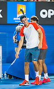 Bernard Tomic (AUS)  in day two play of the 2014 Australian Open at Melbourne's Rod Laver Arena. Tomic forfeited the match blaming leg pain giving R. Nadal the win. One set was completed during match play with Nadal up 6-4.