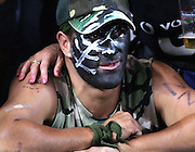 A dejeted New Zealand Sevens fan at the end of the final at the 2005 Rugby World Cup Sevens, Hong Kong, Sunday 20 March 2005. Fiji defeated New Zealand 24-19 to win the Melrose Cup and the 2005 Sevens Rugby World Cup.<br />PHOTO: Andrew Cornaga/PHOTOSPORT