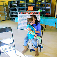 Cathy Rougemont embraces her son Anthony after a run by  the Cibola County Autism Support Group during the 2018 Mount Taylor Quadrathlon in Grants Saturday.