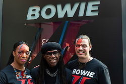 © Licensed to London News Pictures. 25/10/2021. LONDON, UK.  Nile Rodgers, music producer, and shop staff at the opening of a David Bowie pop-up shop in Heddon Street in the West End.  Open 75 days before the late singer's 75th birthday, the pop-up is located close to where Bowie posed as Ziggy Stardust on the cover of his 1972 album The Rise and Fall of Ziggy Stardust and the Spider from Mars.  The store sells limited edition records and memorabilia curated by his estate and will be open until January 2022. A sister shop will open in New York and both form part of a year long celebration of David Bowie's 75th birthday.  Photo credit: Stephen Chung/LNP