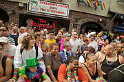 Spectators in front of the Stonewall Inn watch the 2011 Pride Parade in New York's West Village. The Stonewall Inn was the site of the 1969 riots, considered the origin on the gay pride movement.